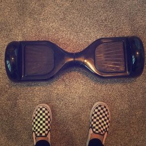A black hover board with lights and a charger